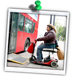 Picture of a mobility scooter user boarding a bus
