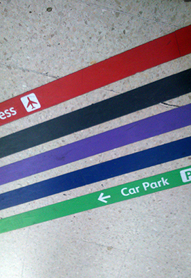 routes printed on the floor in different colours to tell visitors where to go
