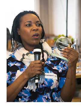 Picture of anne wafula strike with the award