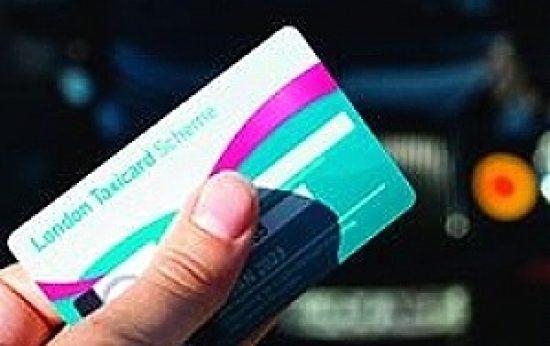 A hand holding a taxicard